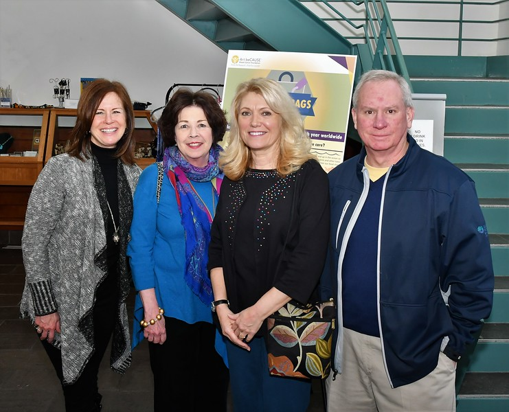 Dru Lindgren, Marsha Cannon welcome Rutland residents, Susan Ethier and Jay Case to the ArtBECAUSE Breast Cancer Foundation Show at the Fitchburg art Museum on Sunday afternoon. SENTINEL & ENTERPRISE/JIM FAY