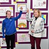 Abbie Huse and her mom, Sharon Huse are all smiles standing in front of cancer awareness art that she and fellow students did on their own time at St. Bernard's Elementary School.