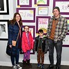 Claudia, Claire, Jack and Chris Norton are shown in front of cancer awareness artwork. Claire, who is one of the artists, is a student at St. Bernard's Elementary School