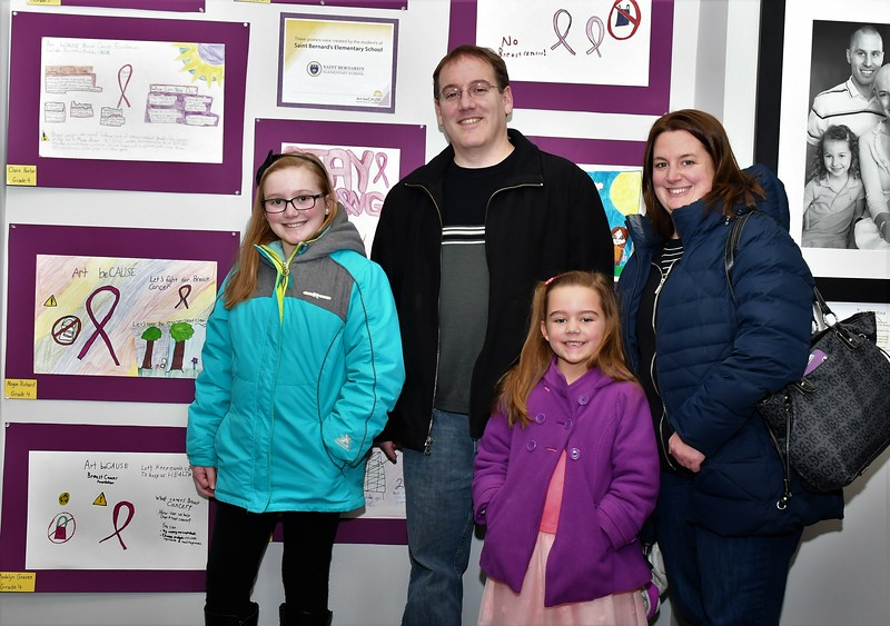 Megan, Brian, Kayla and Deanna Richard pose with Megan's artwork at the Art beCAUSE Breast Cancer Foundation Show at the Fitchburg Art Museum on Sunday.