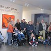 Onlookers listen as Terrana Curatorial Candice Bancheri speaks about Otto Piene during a showing of his work at the Fitchburg Art Museum on Sunday.<br /> SENTINEL & ENTERPRISE / Nick Mallard