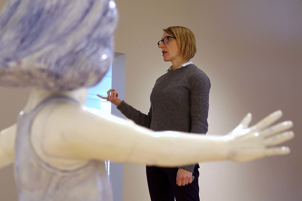 """. Fitchburg Art Museum Curator Lisa Crossman talks about their new show \""""Fantastical, Political\"""" as she stands near this piece of art by Cynthia Consentino called the Twirling Girl  that can be see this Sunday at the opening of the show.  SENTINEL & ENTERPRISE/JOHN LOVE"""