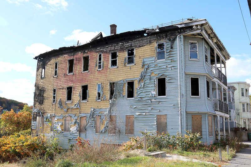 The three family home on 39-43 West St. is among the many buildings the city of Fitchburg plans to demolish in the next two to three weeks. The home was damaged in a May 2015 fire and insurance will help pay for its demolition. SENTINEL & ENTERPRISE/JOHN LOVE
