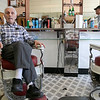 Saturday - Bob Pelullo in his shop Ideal Barbers on Day Street in Fitchburg, March 14, 2020. He has been cutting hair at this shopo since 1961. His father opened it in 1948. He said that he is not that worried about the virus and this is the first time he has seen anything like this. He said that he has not lost any business due to the virus. It is mostly business as usual but he is not really sure how it will effect his business. This is the first time in all his years that he has seen any thing like this. He has bought more hand sanitizer for the shop. SENTINEL & ENTERPRISE/JOHN LOVE