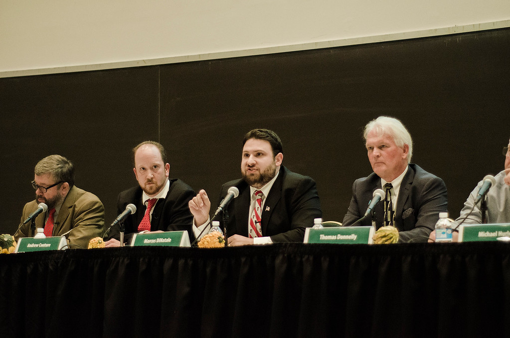 . Candidates David Clark, Andrew Couture, Marcus DiNatale, Thomas Donnelly, Michael Hurley, Kelly Johnson, Sam Squailia, Dean Tran and Anthony Zarrella participate during the Fitchburg City Council At-Large debate held on Wednesday, October 18, 2017 at Fitchburg State University. SENTINEL & ENTERPRISE / Ashley Green