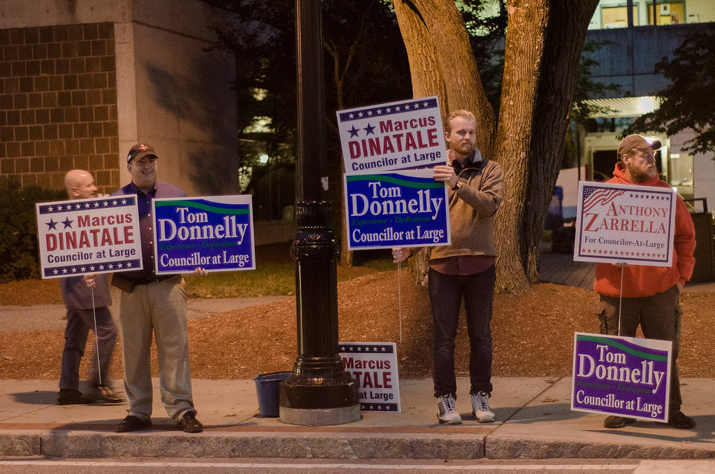 . Supporters hold signs for their candidates ahead of the Fitchburg City Council At-Large debate held on Wednesday, October 18, 2017 at Fitchburg State University. SENTINEL & ENTERPRISE / Ashley Green