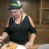 The trial courts across the state made this week Cultural Appreciation Week and the Fitchburg District Court held a Cultural Appreciation Day at the courthouse on Wednesday. Employees of the court brought in foods from the region of the world they or their families are from for the event. Enjoying the luncheon in her German hat is Jennifer Kreidler. SENTINEL & ENTERPRISE/JOHN LOVE
