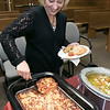 The trial courts across the state made this week Cultural Appreciation Week and the Fitchburg District Court held a Cultural Appreciation Day at the courthouse on Wednesday. Employees of the court brought in foods from the region of the world they or their families are from for the event. Donna DiPasquale who's nationality is French tries some lasagna at the luncheon. SENTINEL & ENTERPRISE/JOHN LOVE