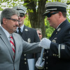 Fitchburg Mayor Steve DiNatale presents Lt Jack Gilmartin with his 20 year pin during the  Fitchburg  Firefighters Memorial Sunday  in the Upper Common. SENTINEL&ENTERPRISE/ Jim Marabello