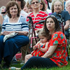 Meghan Cameron, far right,  holds her daughter Olivia while her grandmother, left watches. Cameron's father Jack Mulcahy was remembered during the Fitchburg Fire Department's 66th Annual Firefighters Memorial Sunday  in the Upper Common. Mulcahy was an active duty fireifghter who died after a battle with occupational cancer. SENTINEL&ENTERPRISE/ Jim Marabello