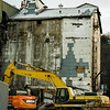 Demolition has begun on the former grain mill on River Street in Fitchburg. SENTINEL & ENTERPRISE / Ashley Green