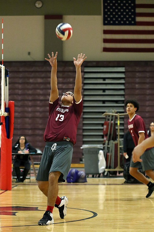 . Abby Kelley High School volleyball played Fitchburg High School at Fitchburg Friday afternoon, April 6, 2018. FHS\'s player Cesar Torres sets the ball during the first game. SENTINEL & ENTERPRISE/JOHN LOVE