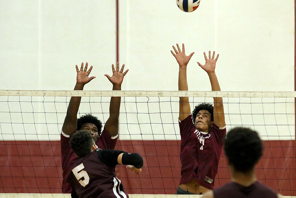 . Abby Kelley High School played Fitchburg High School at Fitchburg Friday afternoon, April 6, 2018. FHS\'s Jaymal Sanchez and Julio Torres jump to block a shot from Abby Kelley player Brandon Nuzzolilo during the game. SENTINEL & ENTERPRISE/JOHN LOVE