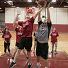 The Fitchburg High School and North Middlesex Regional High School Unified Basketball teams played each other in a game on Wednesday afternoon in the gym at FHS. NM's Johnathon Wencho and FHS's Jack Mara go up for a rebound. SENTINEL & ENTERPRISE/JOHN LOVE