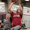 The Fitchburg High School and North Middlesex Regional High School Unified Basketball teams played each other in a game on Wednesday afternoon in the gym at FHS. NM's Alex Kinney tries to stop a shot by FHS's Sam Ramos. SENTINEL & ENTERPRISE/JOHN LOVE