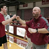 The Fitchburg High School and North Middlesex Regional High School Unified Basketball teams played each other in a game on Wednesday afternoon in the gym at FHS. FHS coach Bryan Baxter fist bumps all the players as they come off the court. SENTINEL & ENTERPRISE/JOHN LOVE