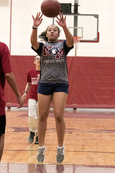 The Fitchburg High School and North Middlesex Regional High School Unified Basketball teams played each other in a game on Wednesday afternoon in the gym at FHS. NM's Erinn Sullivan takes a shot. SENTINEL & ENTERPRISE/JOHN LOVE