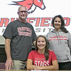 Fitchburg High School soccer player Emerson Scott signed to play at Fairfield University on Wednesday morning. Her dad Jack Scott and mom Annica Scott take a picture with her after she signed to play at the school. SENTINEL & ENTERPRISE/JOHN LOVE