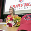 Fitchburg High School soccer player Emerson Scott signed to play at Fairfield University on Wednesday morning. A hat from the school sits on the the table as she gets ready to take pictures with everyone that came to see her sign. SENTINEL & ENTERPRISE/JOHN LOVE