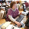 Volunteer at the Fitchburg Historical Society Simone Blake talks about what she does for them at her desk at their offices on main Street Friday morning, April 6, 2018. SENTINEL & ENTERPRISE/JOHN LOVE