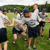 Participants in the Fitchburg Jr. Police Academy work on team building exercises on Wednesday morning at Crocker Field. SENTINEL & ENTERPRISE / Ashley Green