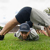 Andrew Cormier, 14,  participates team building exercises during the Fitchburg Jr. Police Academy on Wednesday morning at Crocker Field. SENTINEL & ENTERPRISE / Ashley Green