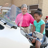 Fitchburg Mayor Stephen DiNatale chats with Alannah Addow, 6, of Leominster as she tries out Officer Michaels Faucher's police motorcycle during Fitchburg's National Night Out on Tuesday. SENTINEL & ENTERPRISE/JOHN LOVE