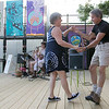 The new stage at Mill Street in Fitchburg had a concert put on by the Fitchburg Public Library featuring the group Ukulele J. They put on a show feature the songs of Hank Williams. Dancing to the music during the show is Erik and Carolyn Jarvi of Fitchburg. SENTINEL & ENTERPRISE/JOHN LOVE