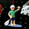Ornament Central, a family-owned wholesaler for ornaments, recently donated 80,000 ornaments to the Fitchburg School. They have ornaments of many styles like this one, a paddle boarder. SENTINEL & ENTERPRISE/JOHN LOVE