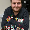 Ornament Central, a family-owned wholesaler for ornaments, recently donated 80,000 ornaments to the Fitchburg School. Manger Rob Casey shows of some of the ornaments at their warehouse in Fitchburg. SENTINEL & ENTERPRISE/JOHN LOVE