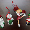 Ornament Central, a family-owned wholesaler for ornaments, recently donated 80,000 ornaments to the Fitchburg School. From left is the first ornament they sold, the one they gave to the schools and then the two most popular, a cheerleader and a gamer. SENTINEL & ENTERPRISE/JOHN LOVE