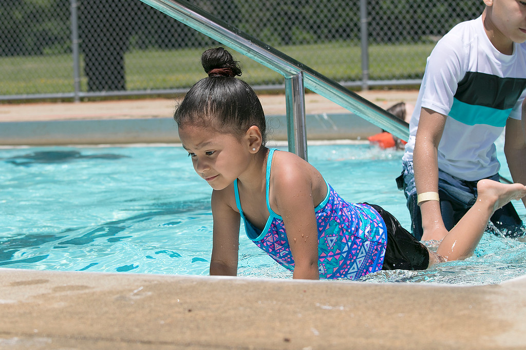 . J. Robert Crowley Swimming Complex at Coolidge Park in Fitchburg is open again for the summer season. having some fun in the water at the pool is Naomi Jaime, 5, from Fitchburg. SENTINEL & ENTERPRISE/JOHN LOVE