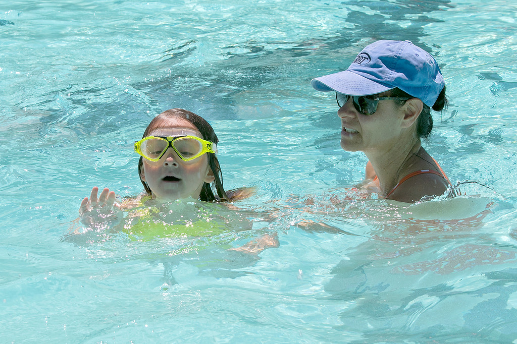 . J. Robert Crowley Swimming Complex at Coolidge Park in Fitchburg is open again for the summer season. Yadi Williams helps her daughter Ariadne Williams, 4, of Fitchburg lean to swim on Friday, June 28, 2019 at the pool.  SENTINEL & ENTERPRISE/JOHN LOVE