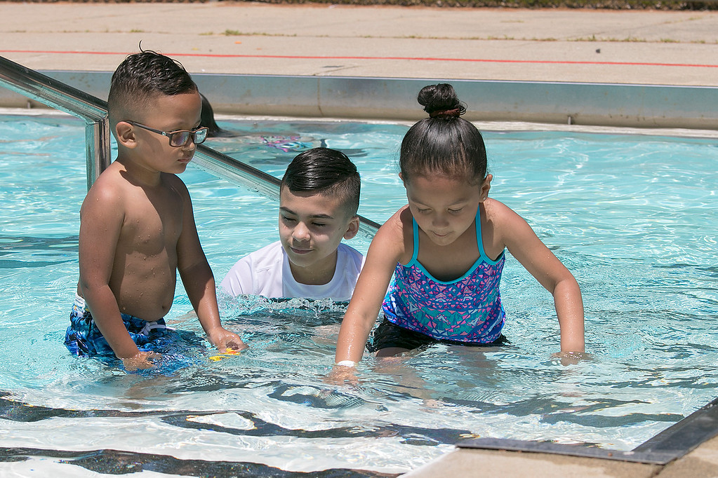 . J. Robert Crowley Swimming Complex at Coolidge Park in Fitchburg is open again for the summer season. Having some fun in the pool on Friday, June 28, 2019 is, from left, Elijah Jaime, 3, Jaiden Jaime, 11, and Naomi Jaime, 5, all of Fitchburg. SENTINEL & ENTERPRISE/JOHN LOVE
