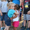 Savannah Northup, 2, hugs Aria George, 1, during the prayer vigil in support of Dallas, TX on Main Street in Fitchburg on Tuesday night. SENTINEL & ENTERPRISE/JOHN LOVE