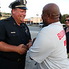 Fitchburg Chief of Police Ernest F. Martineau shakes hands with Pat Mahone of Fitchburg during the prayer vigil in support of Dallas, TX on Main Street in Fitchburg on Tuesday night. SENTINEL & ENTERPRISE/JOHN LOVE