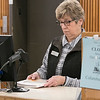 Maureen McSheehy a library Assistant at the Fitchburg Public Library scans in some returned books to the library on Wednesday morning, Oct. 9, 2019. SENTINEL & ENTERPRISE/JOHN LOVE