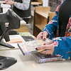 Angela Lopes, working the circulation desk at the Fitchburg Public Library, helps Larry Seggelin of Fitchburg check out the movies he picked on Wednesday, Oct. 9, 2019. SENTINEL & ENTERPRISE/JOHN LOVE