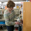 Pre-Professional Librarian Jane Pernaa organizes some books on a shelf in the Fitchburg Public Library on Wednesday morning, Oct. 9, 2019 SENTINEL & ENTERPRISE/JOHN LOVE