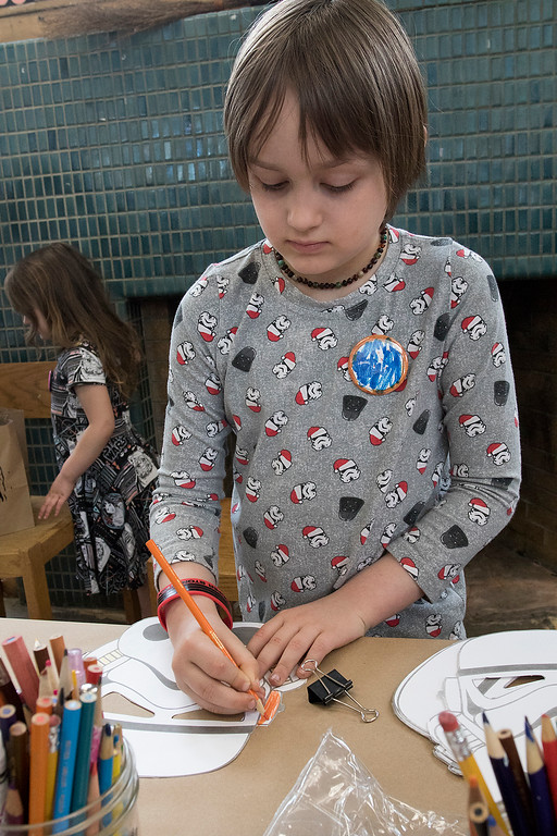 . The Fitchburg Public Library held a Star Wars day on Saturday, May 4, 2019. Decorating a stormtrooper mask during their event is Charlie Beaudry, 6, of Fitchburg. SENTINEL & ENTERPRISE/JOHN LOVE