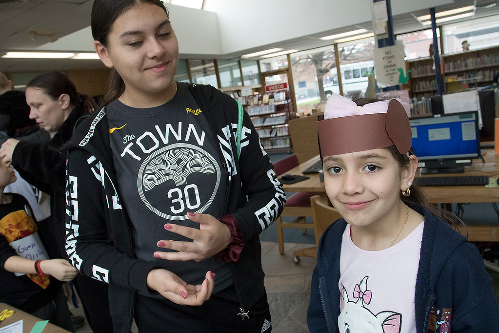 . The Fitchburg Public Library held a Star Wars day on Saturday, May 4, 2019. Natasha Leon, 15, hepled her niece Isabela Leon, 7, make some Princess Leia hair out of construction paper during the event. SENTINEL & ENTERPRISE/JOHN LOVE