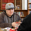 Every Wednesday the Fitchburg Public Library from 4 p.m. to 7:30 p.m. in the teen center at the library they hold a board game and card game teen hangout night With their new Teen Librarian Colin Welch. On Wednesday, March 20, 2019 the teens were playing Magic the card game. Starter packs for the new players were donated by That's Entertainment in Fitchburg. New player Nathan Johnson, 15, listens to Jose Plaza, 19, as he learns how to play Magic. SENTINEL & ENTERPRISE/JOHN LOVE