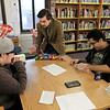 Every Wednesday the Fitchburg Public Library from 4 p.m. to 7:30 p.m. in the teen center at the library they hold a board game and card game teen hangout night With their new Teen Librarian Colin Welch. On Wednesday, March 20, 2019 the teens were playing Magic the card game. Starter packs for the new players were donated by That's Entertainment in Fitchburg. Welch talks to new player Nathan Johnson, 15, about the starter packs and what they do so he could chose one that he will  be able to keep. Waiting to play Johnson and help him learn the game is Jose Plaza, 19 on right. SENTINEL & ENTERPRISE/JOHN LOVE