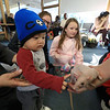 Animal Adventures, a family zoo and rescue center, from Bolton visited the Fitchburg Public Library on Thursday morning, December 28, 2018. The program was funded by the United Way's Strengthening Families grant. Drew Shaheen from the zoo holds a hairless rat for the kids to see, learn about and pet. Azzam Azis, 11 months, pets the hairless rat. SENTINEL & ENTERPRISE/JOHN LOVE
