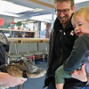Animal Adventures, a family zoo and rescue center, from Bolton visited the Fitchburg Public Library on Thursday morning, December 28, 2018. The program was funded by the United Way's Strengthening Families grant. Drew Shaheen from the zoo holds an American alligator for the kids to see, learn about and pet. Mike Hove holds his son Oliver, 2, as they see how the alligator felt. SENTINEL & ENTERPRISE/JOHN LOVE