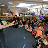 Animal Adventures, a family zoo and rescue center, from Bolton visited the Fitchburg Public Library on Thursday morning, December 28, 2018. The program was funded by the United Way's Strengthening Families grant. Drew Shaheen from the zoo holds a bearded dragon for the kids to see, learn about and pet. SENTINEL & ENTERPRISE/JOHN LOVE
