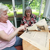 Fitchburg Rotary Club is celebrating 100 years Members of the club talked about their up coming celebration on Friday afternoon. Members Mary Whitney and Karen Fusco look over a pull out that the Sentinel & Enterprise put out for the clubs 50th celebration. SENTINEL & ENTERPRISE/JOHN LOVE