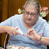 The Fitchburg Senior Center held  a class in seashell wreath making on Friday morning with artist Laura Darrow from Sterling. Student Anne Marie Lewis works on her wreath during the class. SENTINEL & ENTERPRISE/JOHN LOVE