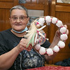 The Fitchburg Senior Center held  a class in seashell wreath making on Friday morning with artist Laura Darrow from Sterling.. Showing off her finished wreath is Deborah Boisine. SENTINEL & ENTERPRISE/JOHN LOVE