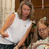 The Fitchburg Senior Center held  a class in seashell wreath making on Friday morning with artist Laura Darrow from Sterling.. Student Katherine McLellan gets help from Darrow during the class. SENTINEL & ENTERPRISE/JOHN LOVE